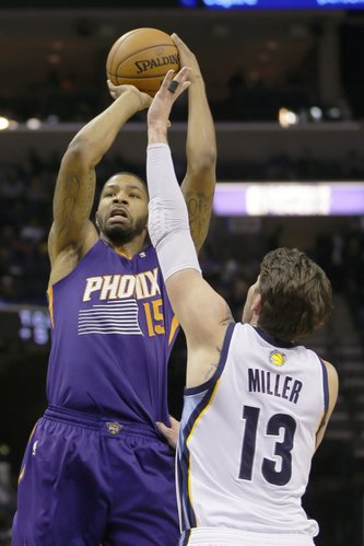 Phoenix Suns' Marcus Morris (15) shoots over Memphis Grizzlies' Mike Miller (13) in the first half of an NBA basketball game in Memphis, Tenn., Tuesday, Dec. 3, 2013. (AP Photo/Danny Johnston)