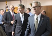 U.S. Attorney Barry Grissom, right, followed by Kansas Gov. Sam Brownback, leaves a news conference after announcing the arrest of Terry Lee Loewen, 58, of Wichita, Kan., on Friday, Dec. 13, 2013, in Witchita, Kan. Grissom said Loewen was arrested Friday morning at Mid-Continent regional airport where he planned to drive a car that he believed was full of explosives into a terminal at the airport. (AP Photo/The Wichita Eagle, Travis Heying)