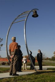 "This 2007 file photo pictures the unveiling of ""Beacon"" at Fire and Medical Station 4, 2121 Wakarusa Drive. The sculpture, created by Gail Simpson and Aristotle Georgiades of Actual Size Artworks in Staughton, Wis., was commissioned by the city of Lawrence at a cost of $38,000 as part of the city&squot;s Percent for Art program."