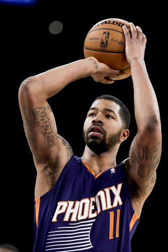 Phoenix Suns forward Markieff Morris shoots during the second half of an NBA basketball game against the Los Angeles Lakers in Los Angeles, Tuesday, Dec. 10, 2013. (AP Photo/Chris Carlson)