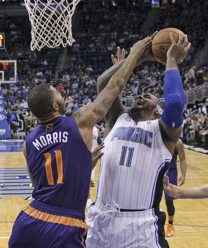 Orlando Magic's Glen Davis, right, attempts a shot over Phoenix Suns' Markieff Morris during the first half of an NBA basketball game in Orlando, Fla., Sunday, Nov. 24, 2013.(AP Photo/John Raoux)