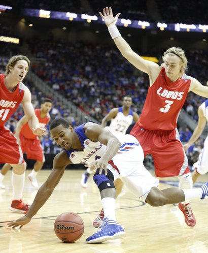 Kansas guard Wayne Selden tries to maintain control of the ball as he is defended by New Mexico players Cameron Bairstow (41) and Hugh Greenwood (3) during the first half on Saturday, Dec. 14, 2013 at Sprint Center in Kansas City, Mo.
