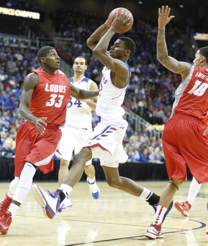 Kansas guard Andrew Wiggins drives to the bucket against New Mexico guard Deshawn Delaney during the first half on Saturday, Dec. 14, 2013 at Sprint Center in Kansas City, Mo.