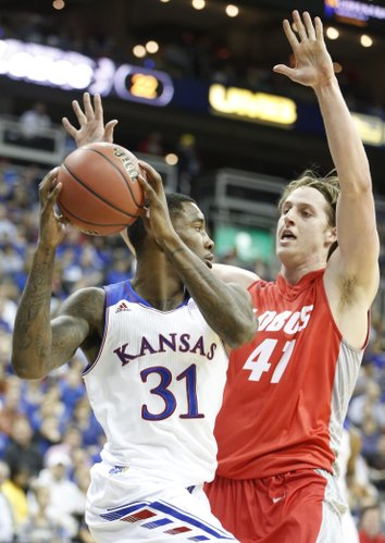 Kansas forward Jamari Traylor is covered by New Mexico forward Cameron Bairstow during the first half on Saturday, Dec. 14, 2013 at Sprint Center in Kansas City, Mo.