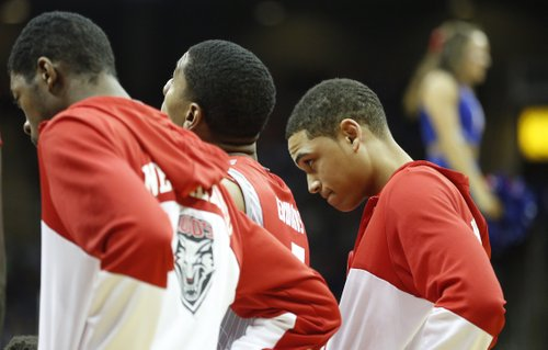 Former Kansas player and New Mexico forward Merv Lindsay listens during a huddle in the first half on Saturday, Dec. 14, 2013 at Sprint Center in Kansas City, Mo.