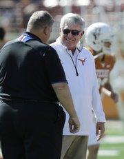 Kansas coach Charlie Weis, left, and Texas coach Mack Brown visit prior to their Nov. 2 game in Austin, Texas.