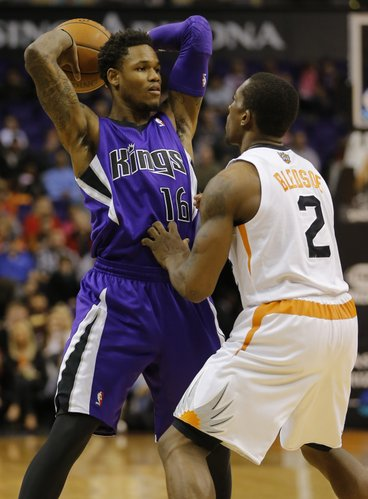 Sacramento Kings' Ben McLemore (16) looks to pass over Phoenix Suns' Eric Bledsoe (2) during the first half of an NBA basketball game, Friday, Dec. 13, 2013, in Phoenix. (AP Photo/Matt York)