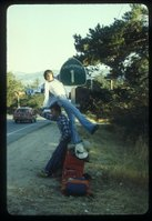 Hitchhiking in 1978 in California.... That is me hanging off of the sign.