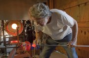 Vernon Brejcha works in his studio south of Lawrence shaping hot glass into works of art.