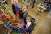 Mary Lou LaFauce and her son Adam, 11, of Kankakee, Ill., play with a Q-Ba-Maze display at the Toy Store, 936 Massachusetts St. Q-Ba-Maze, a build-your-own marble run set, has been a popular gift this year at the Toy Store.