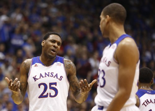 Kansas forward Tarik Black (25) and Landen Lucas discuss a gameplan during the first half on Saturday, Dec. 21, 2013 at Allen Fieldhouse.