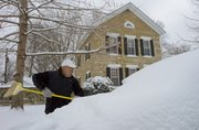 Jim Nichols, Lawrence, starts the process of removing snow from his buried car Sunday morning outside his home in Old West Lawrence. Nichols was hoping roads would be clear enough to drive to Parsons. The Lawrence area received about 6-inches of snow Saturday night and into Sunday morning.
