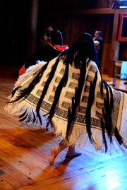 Grace Denning, a Haskell student and member of the Tlingit tribe of Alaska, wears a raven's tail robe during a traditional dance performance. The traditional Tlingit robe was hand-twined, without the use of a loom, by artist Teri Rofkar.