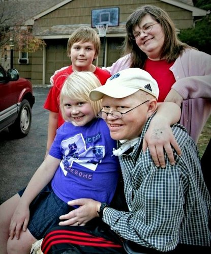 Finn Bullers and his family in Facebook posting announcing that his KanCare case manager visited his home on Christmas Eve to tell him his previous Medicaid coverage level had been fully restored.