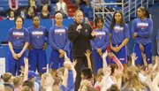 Kansas University coach Bonnie Henrickson, center, and the KU women's basketball team greet young fans during a holiday hoops clinic, Friday, Dec. 27, 2013, at Allen Fieldhouse.