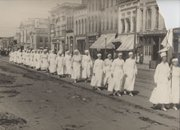 "Red Cross nurses march down Massachusetts Street during the Liberty Bond parade of 1918. This photo is featured in ""Celebration Central: Parades on Massachusetts Street,"" a photo exhibit at the Watkins Museum of History."