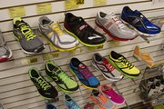Men's running shoes for sale are on display at Garry Gribble's.