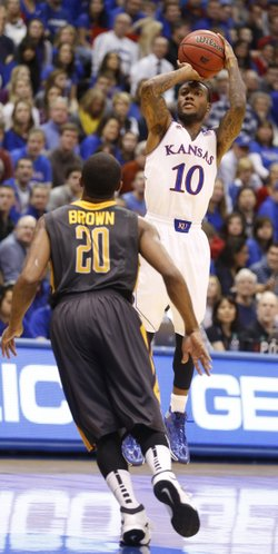 Kansas guard Naadir Tharpe lines up a three before Toledo guard Julius Brown during the first half on Monday, Dec. 30, 2013 at Allen Fieldhouse.