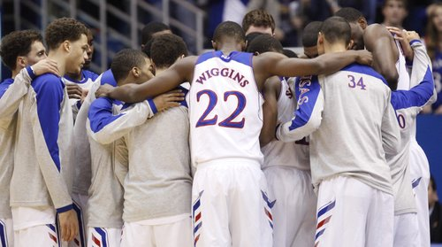 The Kansas Jayhawks huddle up before tipoff against Toledo on Monday, Dec. 30, 2013 at Allen Fieldhouse.
