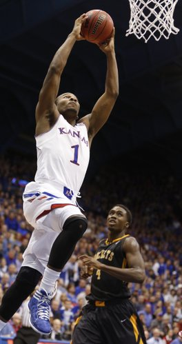 Kansas guard Wayne Selden elevates for a jam before Toledo guard Justin Drummond during the second half on Monday, Dec. 30, 2013 at Allen Fieldhouse.
