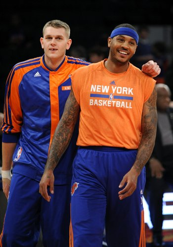 New York Knicks small forward Carmelo Anthony (7), right laughs with teammate Cole Aldrich (45) during pre game practice before the NBA basketball game against the Boston Celtics on Sunday, Dec. 8, 2013, in New York. (AP Photo/Kathy Kmonicek)