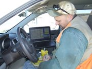 Brownie Wilson of the Kansas Geological Survey documents data about well depths in the Ogallala Aquifer and uploads information into a database at Kansas University. The information helps farmers estimate the usable life remaining in their groundwater supplies.