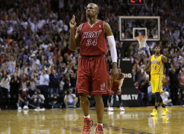 Miami Heat's Ray Allen reacts after making a 3--pointer to put the Heat ahead in the second half of an NBA basketball game against the Indiana Pacers, Wednesday, Dec. 18, 2013, in Miami. The Heat won 97-94. (AP Photo/Lynne Sladky)