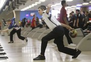 Lawrence Free State bowler Nick Crawford bowls during the FSHS Invitational bowling tournament Saturday at Royal Crest Lanes