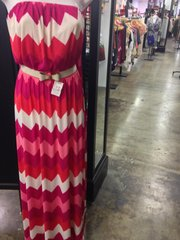 Radiant Orchid can also be found in patterns, a spring maxi dress ($33.98) at Envy, 911 Massachusetts, with the color boldly zig-zagged across the fabric along with white and shades of pink.