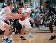 Tristan Garber (10) reaches for a loose ball as Free State boys played Shawnee Mission East Tuesday, Jan. 7, 2014 in Prairie Village.