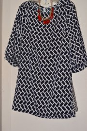 A chevron print shirt-dress ($42) and necklace/earrings set ($25) from Britches.