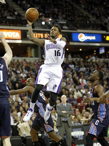 Sacramento Kings guard Ben McLemore (16) shotts against the Charlotte Bobcats during the second half of an NBA basketball game in Sacramento, Calif., on Saturday, Jan. 4, 2014. The Bobcats beat the Kings 113-103.(AP Photo/Steve Yeater)
