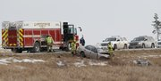 Lawrence-Douglas County Fire & Medical personnel work the scene of a two-car crash that left one person dead early Wednesday, January 8. One person died in a two-vehicle crash this morning near the Kansas Turnpike's Lecompton exit. The victim's identity and the identity of other people involved in the crash, reported at 6:52 a.m.