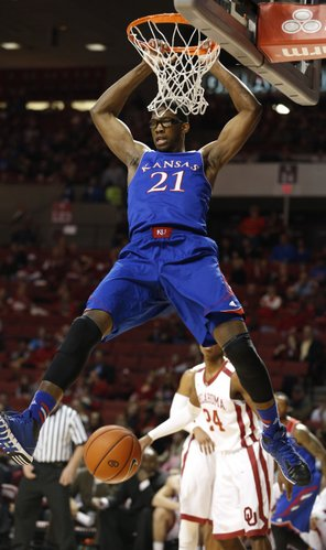Kansas center Joel Embiid comes down from a dunk against Oklahoma during the first half on Wednesday, Jan. 8, 2013 at Lloyd Noble Center in Norman, Oklahoma.