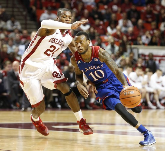 Kansas guard Naadir Tharpe drives around Oklahoma guard Buddy Hield during the second half on Wednesday, Jan. 8, 2013 at Lloyd Noble Center in Norman, Oklahoma.