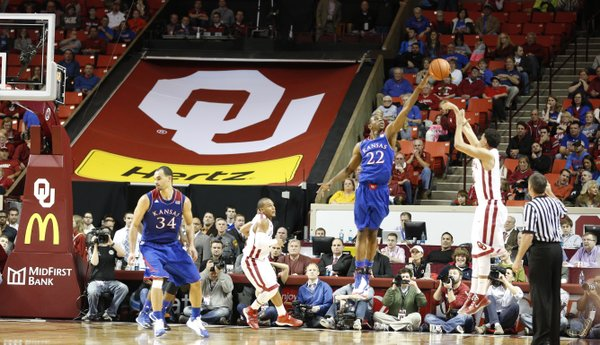 Kansas guard Andrew Wiggins blocks a late three from Oklahoma guard Frank Booker during the second half on Wednesday, Jan. 8, 2013 at Lloyd Noble Center in Norman, Oklahoma.