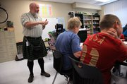Paul Corcoran, who teaches sixth-grade math and language arts at Lawrence's West Middle School, wears kilts to school most days of the week to celebrate his Irish heritage.