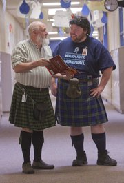 From left, Paul Corcoran and Holden Kraus both teach math at Lawrence's West Middle School and often wear kilts to class. Students are convinced they're father and son (they're not).
