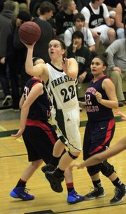 Free State's Scout Wiebe (22) shoots against Olathe North on Friday, Jan. 10, 2014, at FSHS.