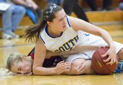 Olathe South's Makayla Gooch, top, lands on top of Lawrence High freshman Jaycie Bishop as they get on the floor for a loose ball during their basketball game, Friday evening in Olathe.
