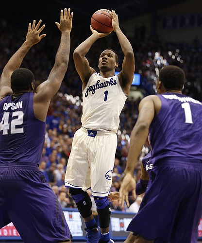 Kansas guard Wayne Selden floats into the lane for a shot before Kansas State defenders Thomas Gipson and Shane Southwell during the second half on Saturday, Jan. 11, 2013 at Allen Fieldhouse.
