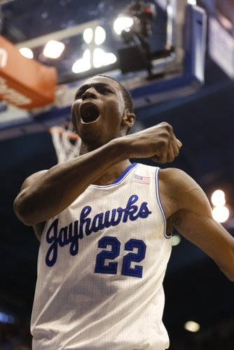 Kansas guard Andrew Wiggins celebrates after delivering on a breakaway dunk against Kansas State during the second half on Saturday, Jan. 11, 2014 at Allen Fieldhouse.