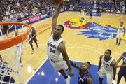Kansas guard Andrew Wiggins gets up for a dunk over Kansas State guard Marcus Foster during the second half on Saturday, Jan. 11, 2013 at Allen Fieldhouse.
