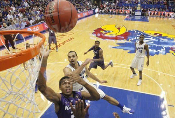 Kansas guard Perry Ellis and Kansas State guard Wesley Iwundu battle for a rebound during the second half on Saturday, Jan. 11, 2013 at Allen Fieldhouse.