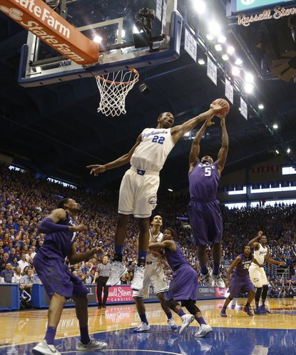 Kansas guard Andrew Wiggins battles for a rebound with Kansas State guard Jevon Thomas during the second half on Saturday, Jan. 11, 2014 at Allen Fieldhouse.