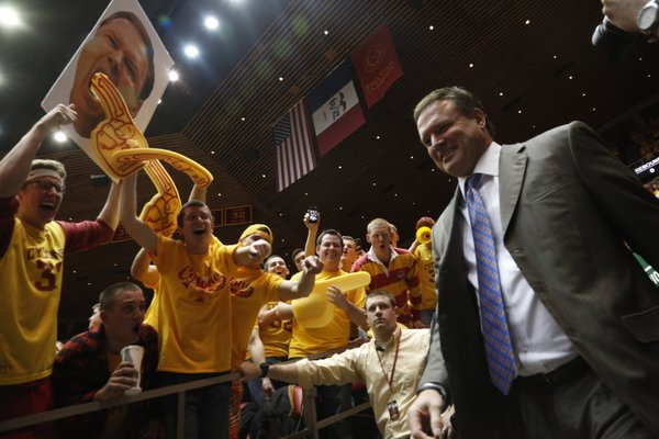 Kansas head coach Bill Self takes some ribbing from the Iowa State student section as he takes the court before tipoff on Monday, Jan. 13, 2014 at Hilton Coliseum in Ames, Iowa.