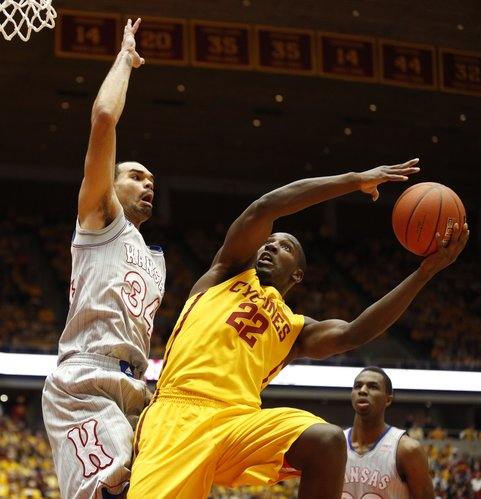 Kansas forward Perry Ellis defends against a shot from Iowa State forward Dustin Hogue during the first half on Monday, Jan. 13, 2014 at Hilton Coliseum in Ames, Iowa.