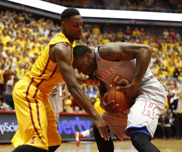 Kansas forward Tarik Black pulls a rebound from Iowa State forward Melvin Ejim during the first half on Monday, Jan. 13, 2014 at Hilton Coliseum in Ames, Iowa.