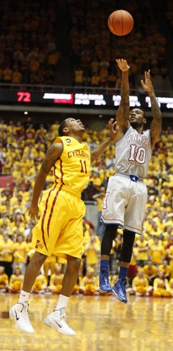 Kansas guard Naadir Tharpe puts up a shot over Iowa State guard Monte Morris during the second half on Monday, Jan. 13, 2014 at Hilton Coliseum in Ames, Iowa.