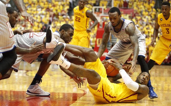 Kansas guards Andrew Wiggins, left, and Naadir Tharpe look to tie up Iowa State guard DeAndre Kane during the first half on Monday, Jan. 13, 2014 at Hilton Coliseum in Ames, Iowa.
